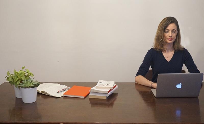Website copywriter working on laptop